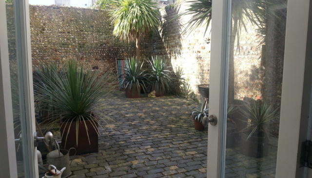Victorian, whitewashed, end of terrace with courtyard