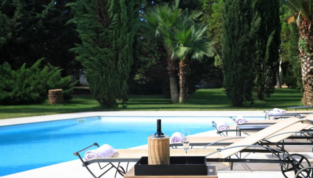 A luxuriously appointed villa with stunning grounds and pool.